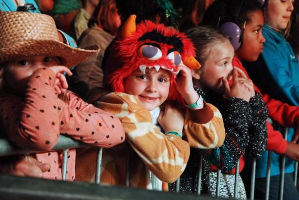 child in fancy dress monster hat