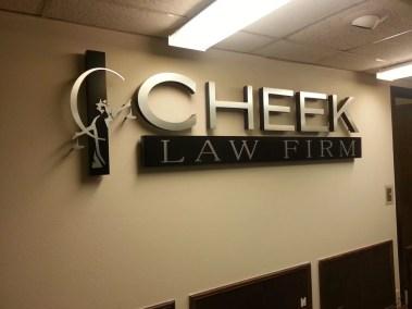Cheek Law Firm Logo Sign