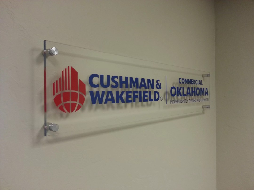 Image of clear acrylic logo sign installed in the lobby of Commercial Oklahoma