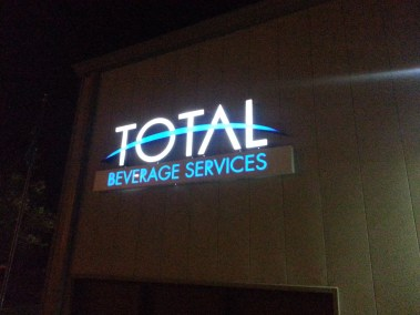 Total Beverage Logo Sign At Night