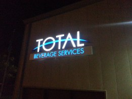 Picture of a channel letter logo sign at night after installation.