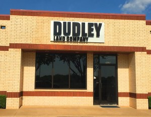 Picture of exterior logo sign for Dudley Land Company.