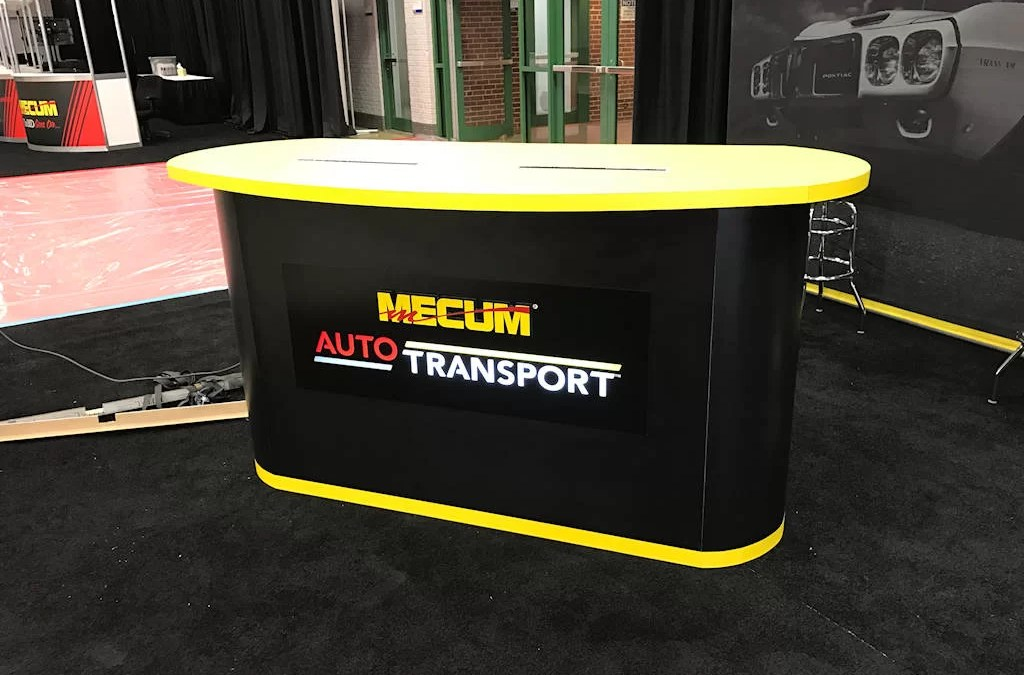 Custom Desk Signs for Mecum Auto Auction Designed by Electremedia