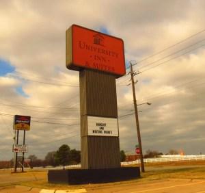 Daytime picture of University Inn pylon sign.