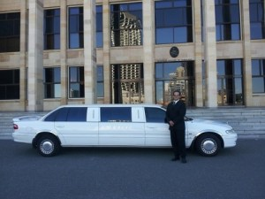 man in front of limo