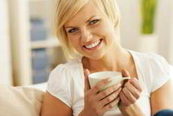 Smiling lady drinking coffee