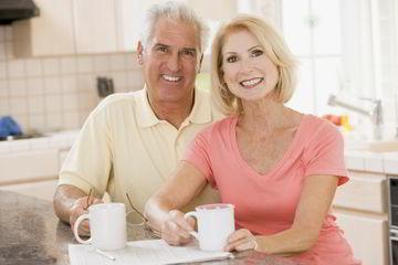 Couple savoring fresh from their espresso machine