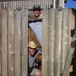 the boys playing with the fence