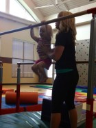 Iris conquers the uneven bars.