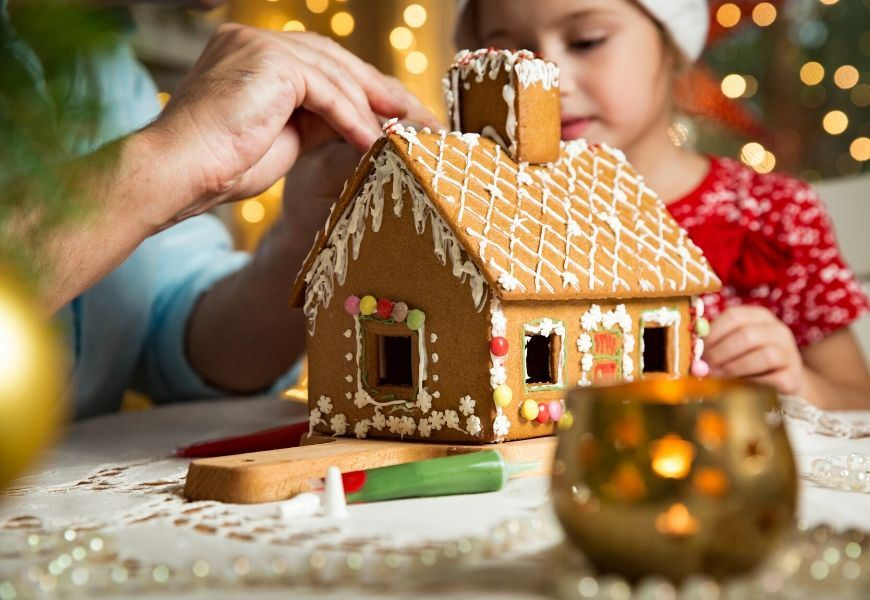building a gingerbread house with child