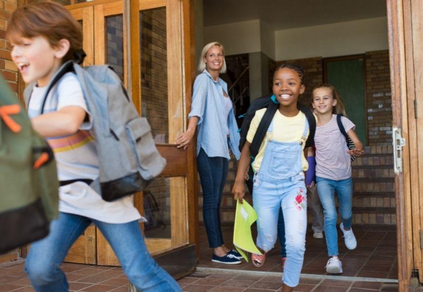 children happily leaving school