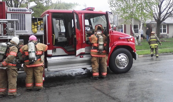 Photo Credit: Al Colombo -FireFighters after fighting a house fire in Circleville, Ohio (image)