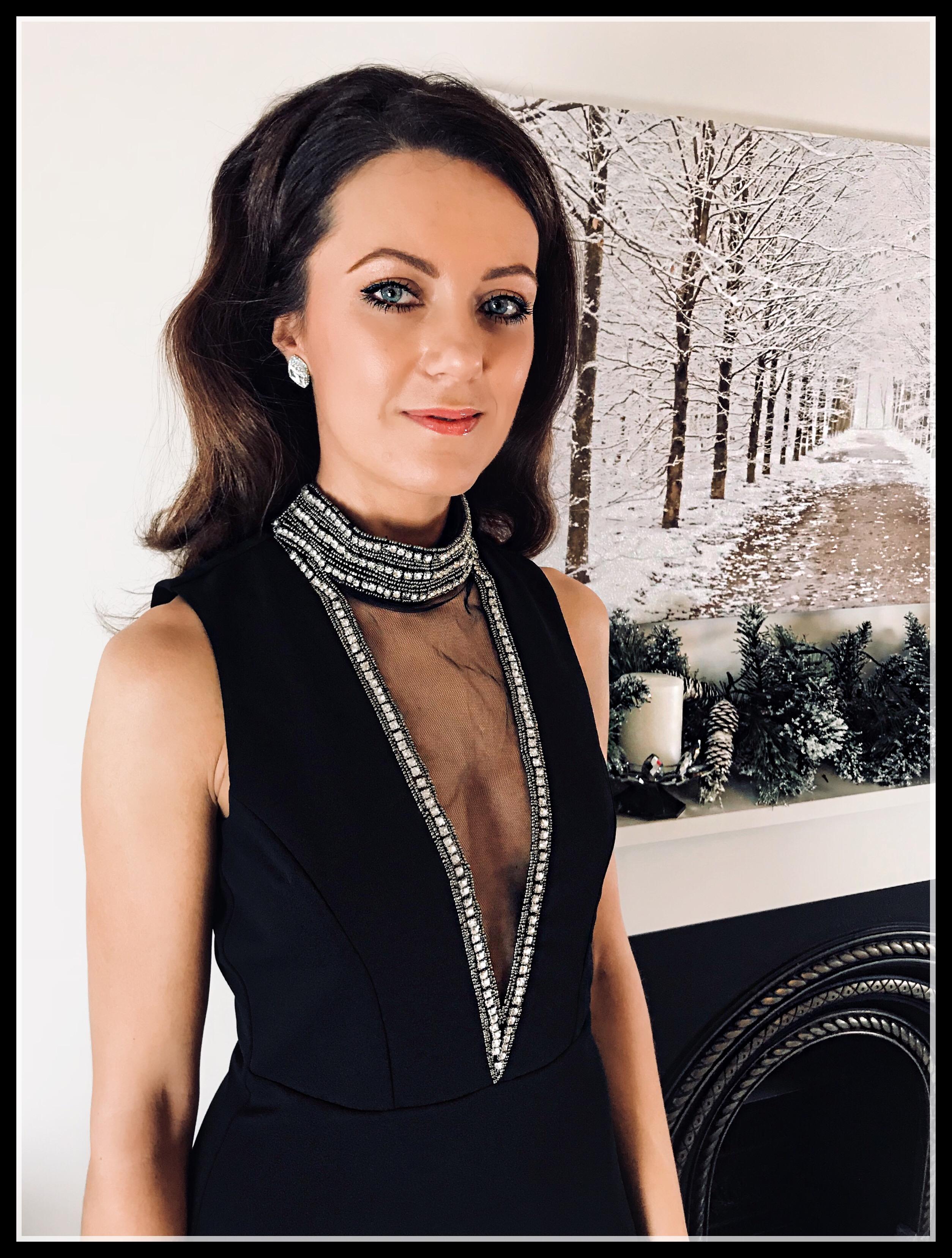 Stephanie Pratt – Goddiva High Neck Cut Out Embellished Maxi Dress | River IslandGold Bow Court | Miss Kg Tutu Glitter Blow Clutch | Swarovski earrings