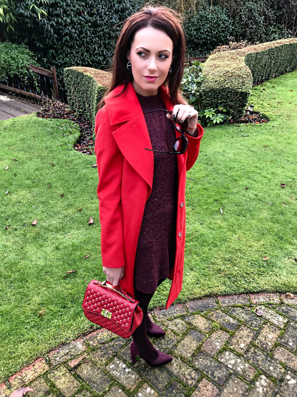 Miss Selfridge Smart Midi Coat | V by Very Quilt and Stud Satchel | River Island River Island Knitted Over The Knee Boots- Dark Red | Abercrombie & Fitch Burgundy Long Sleeve Knit Dress Shades of Valentine | Red long coat & Burgundy boots | Swarovski earrings | Baroque Prada sunglasses