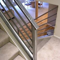 Elegant Iron Studios Custom Ornamental Metalwork Modern | Staircase Steel Railing Designs With Glass | Glass Panel Wooden Handrail | Modern Style | Stair Glass Void | Curved | Metal