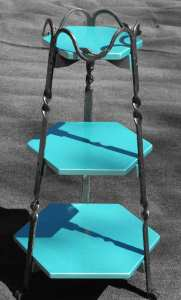 hexagonal table with emerald colored shelves