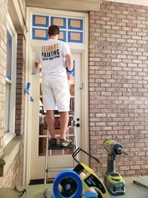 spraying wood door