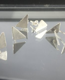 privacy policy page with triangle stud earrings