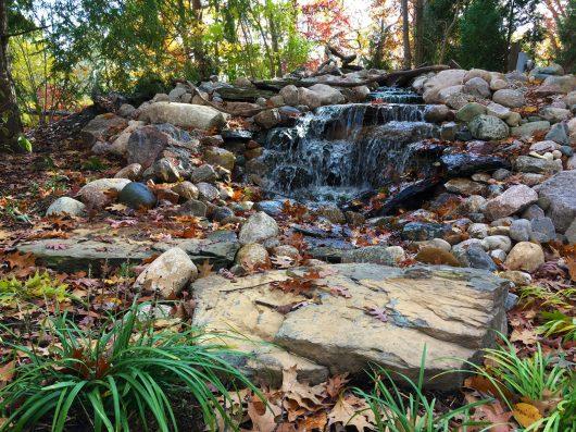 The cascading waterfall at Sensory Garden entrance