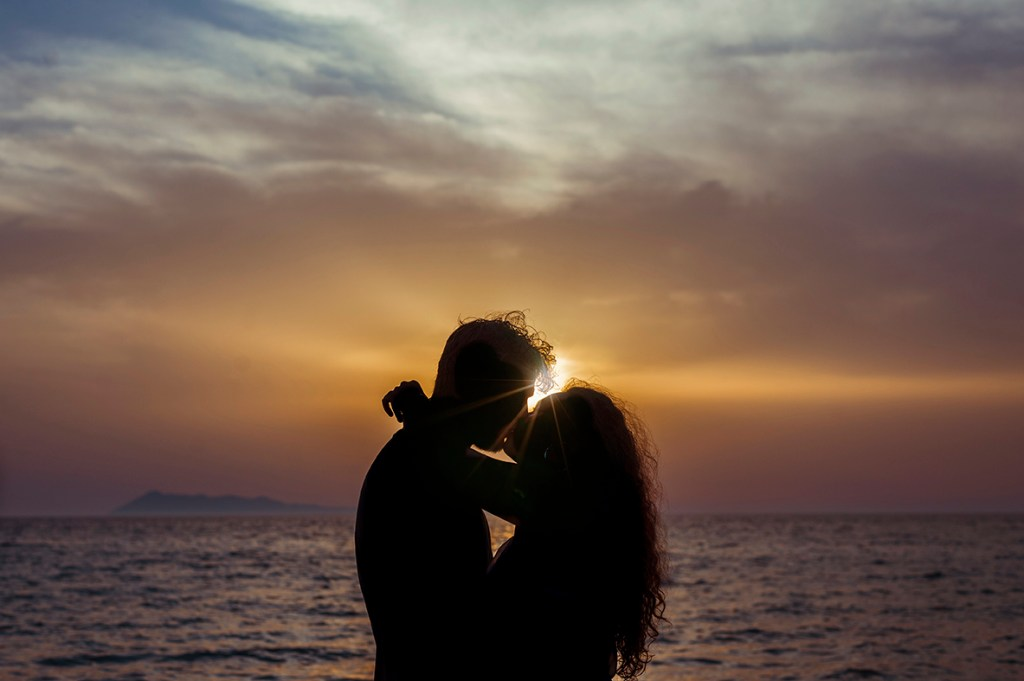 Greece Destination Engagement - Corfu - silhouette of a kiss with sunset in background