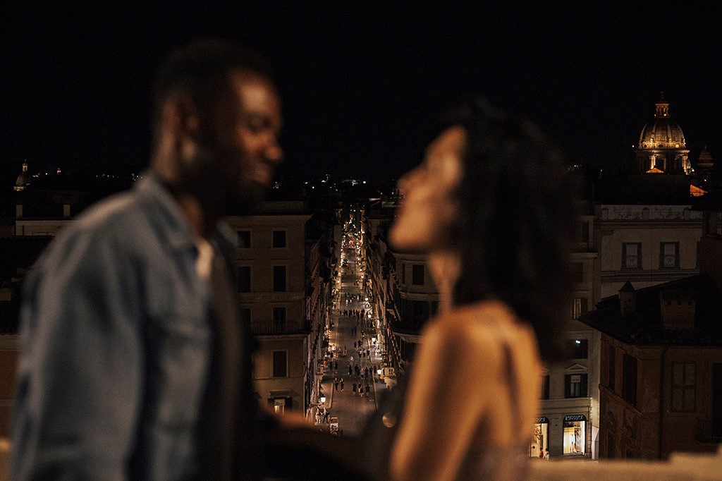 Rome view from Trinità dei Monti, interacial couple blurred in the frame