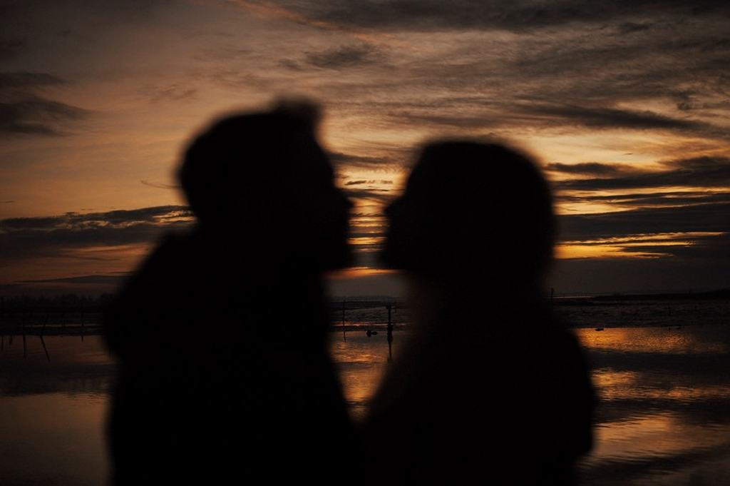 blurred silhouette of a couple with sunset background