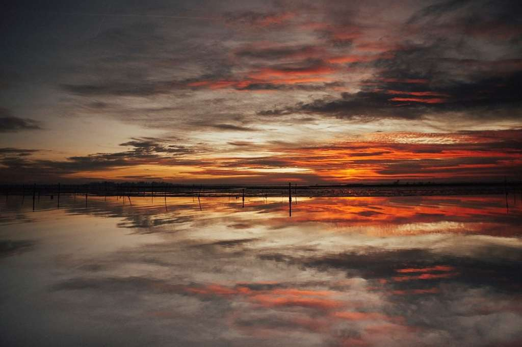 amazing sunset landscape reflected on a lagoon