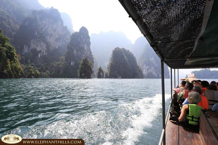 Cheow Larn Lake exploration on longtail boat while heading to the floating Elephant Hills Rainforest Camp