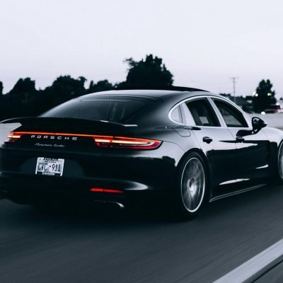 black sports sedan driving