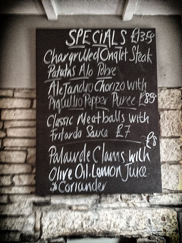 Specials blackboard at El Gato Negro Tapas