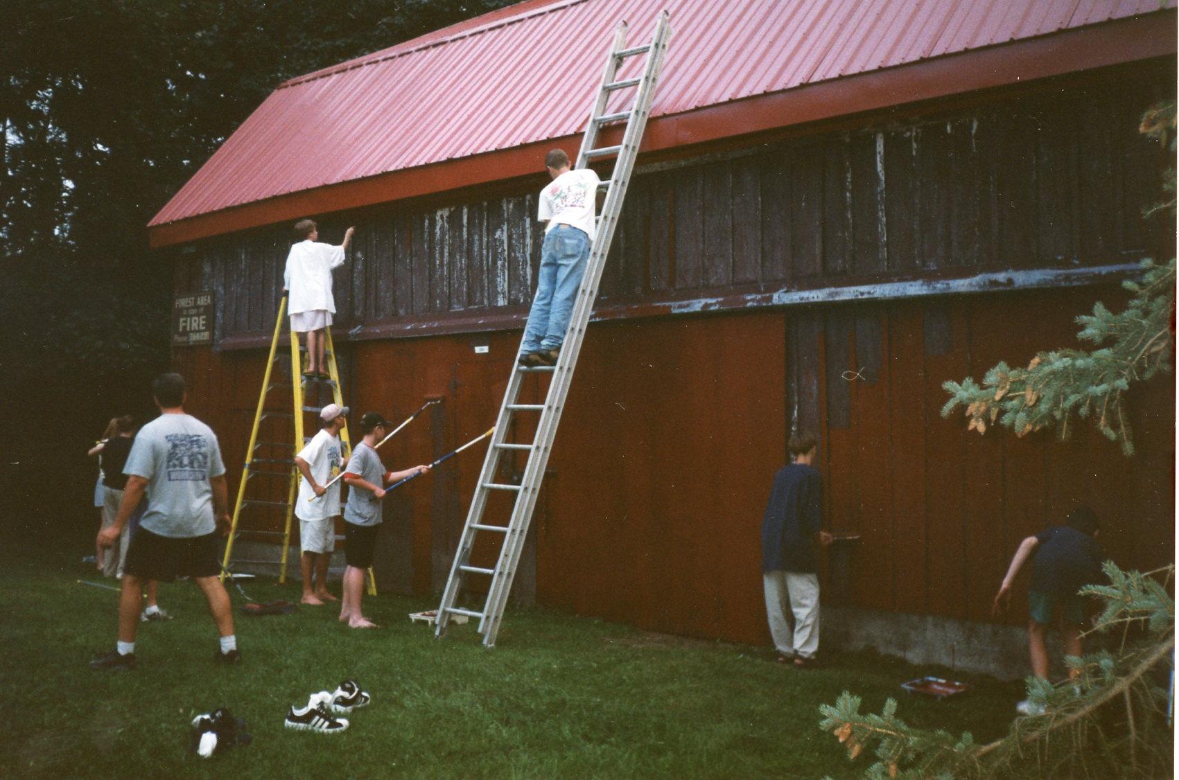Volunteers painting barn in 2000.