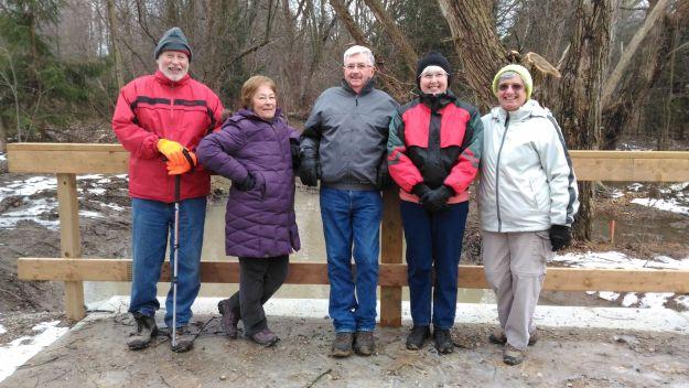 Group on new concrete bridge on McKenzie Trail in December.