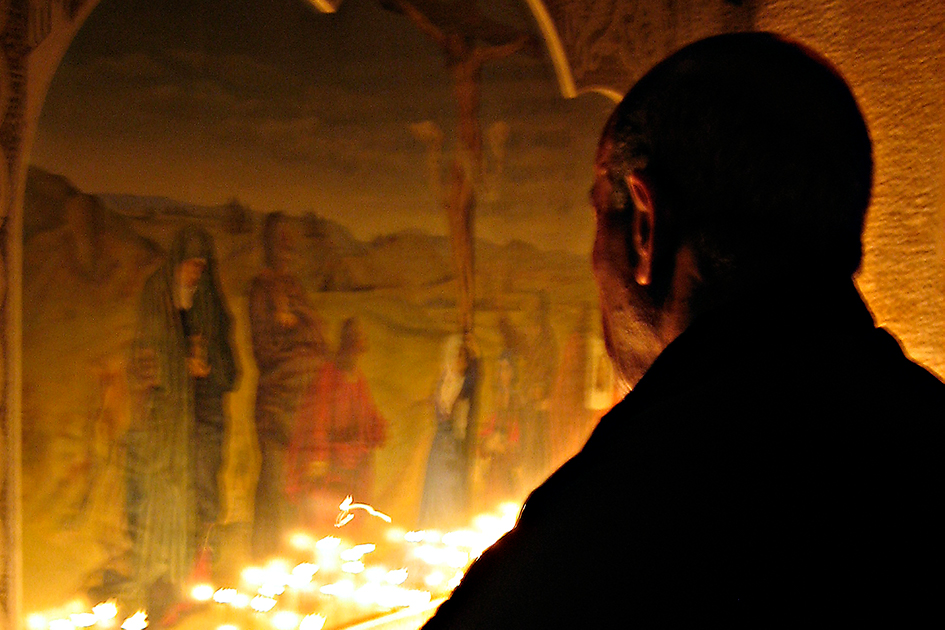 Man praying in church in Syria