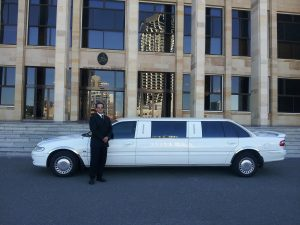 man standing near white limo