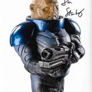 Dan Starkey Signed Strax 10x8