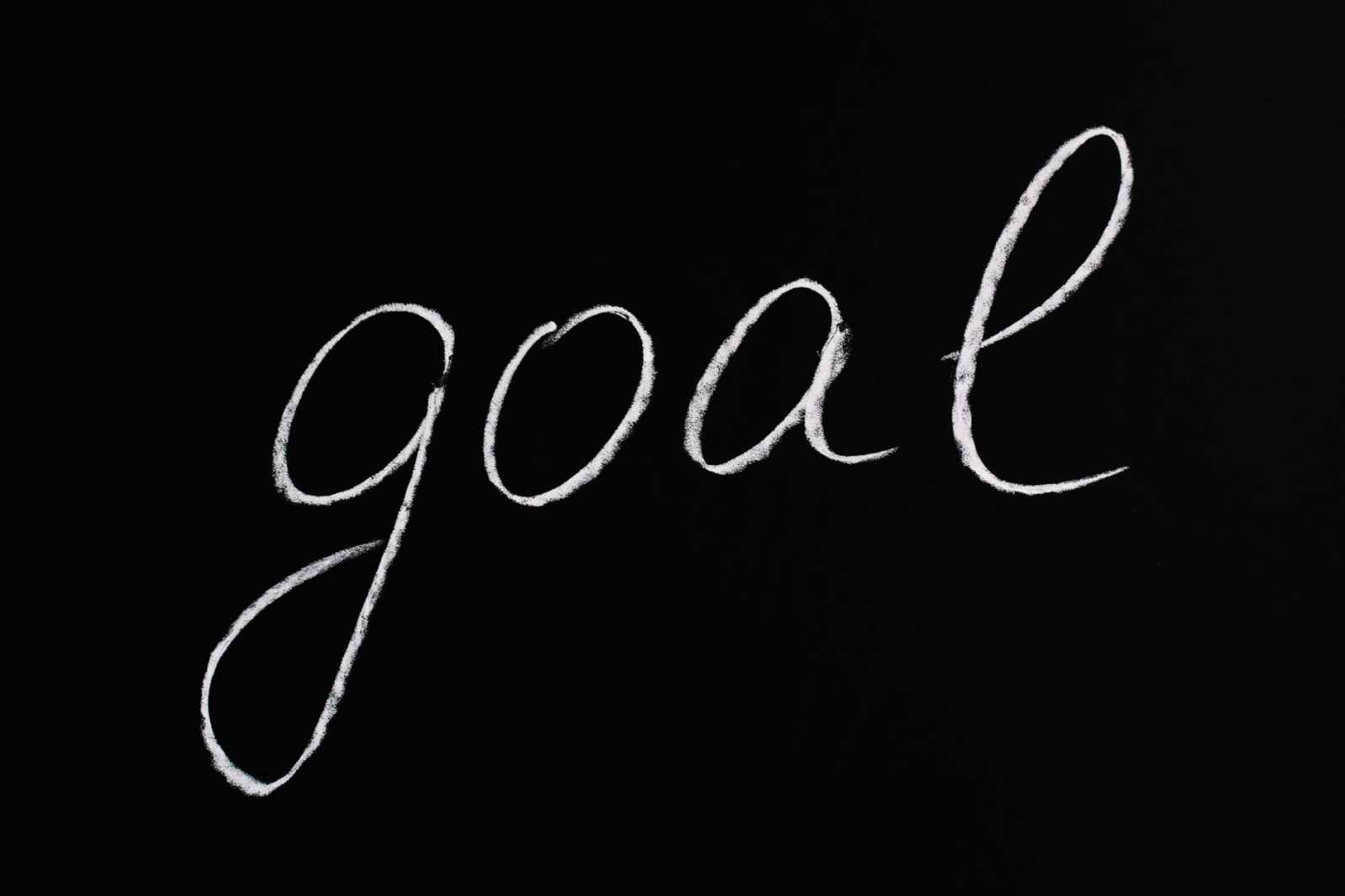 goal lettering text on black background