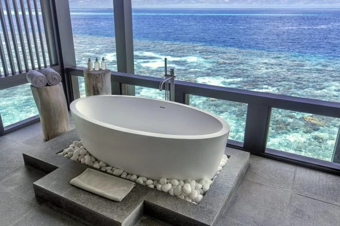 kudadoo private island bathtub overlooking ocean