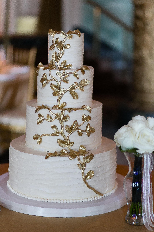 White Wedding Cake With Gold Leaf
