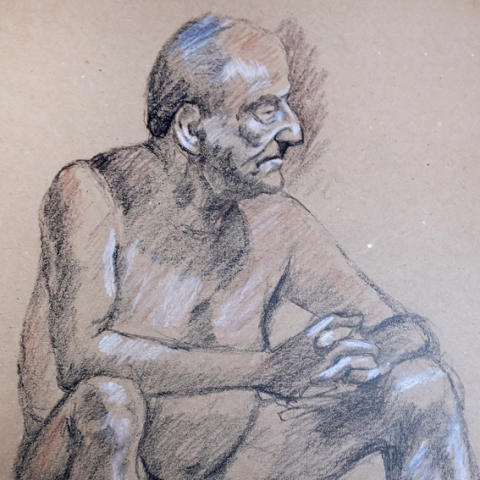 Seated male figure drawing in charcoal and chalk