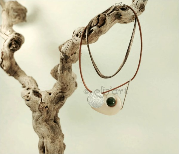 Contmporary necklace in silver, vegetal ivory, jade, brass an leather by Eliz'art