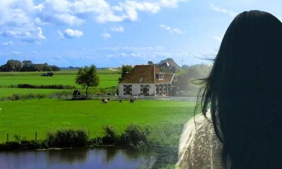 woman staring at farm house