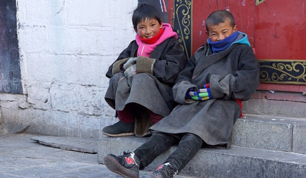 Lhasa: young boys sitting at Barkhor Street