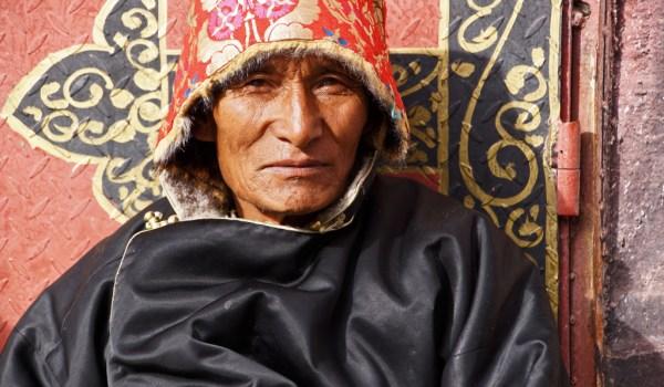 Lhasa: portrait of a pilgrim at Barkhor Street