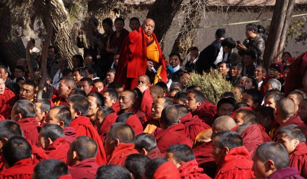Special ceremony at Sera Monastery, Lhasa: the baktsamaku (discipline monk) walking round