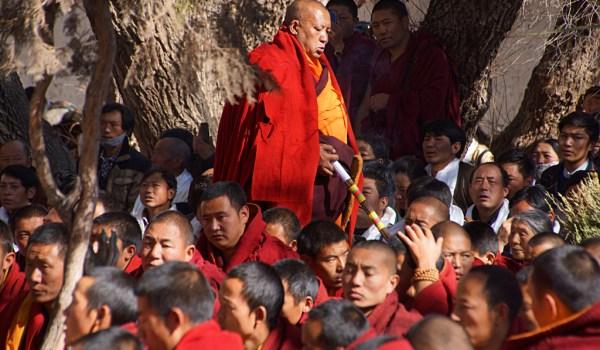 Special ceremony at Sera Monastery, Lhasa: the baktsamaku (discipline monk) walking round