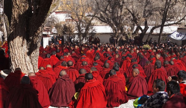 Special ceremony at Sera Monastery, Lhasa: monks sitting and chanting in the debating courtyard