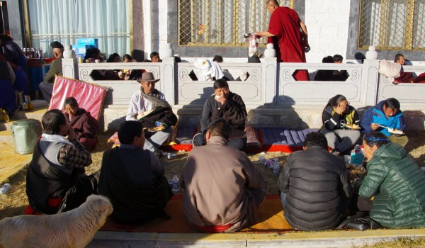 Special ceremony at Sera Monastery, Lhasa: after paying their respects there was a buffet with al kind of food for the well-wishers. They were eating outside in the sun