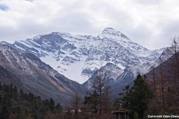 Huanglong National Park: view on a snow mountain behind the park