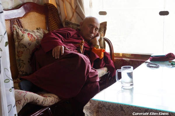 Sleeping monk in the restaurant of monastery high above the town of Guanyinqiao