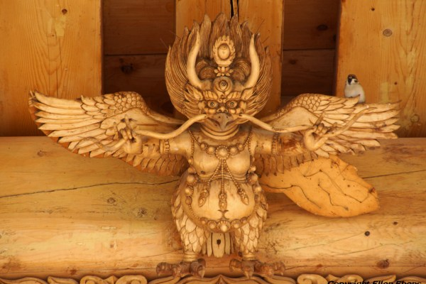 Wood carving with bird at the entrance of a hall at Labang Monastery, Xiahe